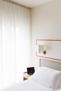 Letto o letti in una camera di Hotel America