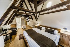 A bed or beds in a room at Archibald At the Charles Bridge