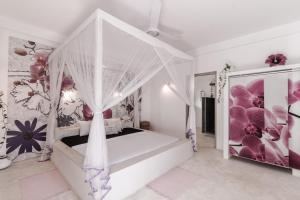 A bed or beds in a room at Kirinuga Boutique Retreat