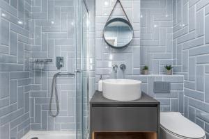 Koupelna v ubytování Apartament Zielna by Your Freedom