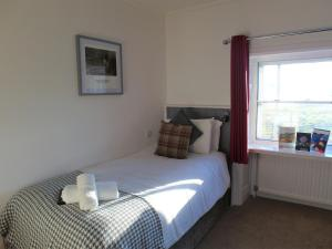 A bed or beds in a room at Brathay Hall - Brathay Trust
