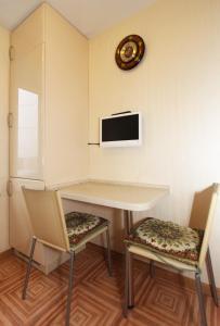 Телевизор и/или развлекательный центр в ApartLux Улучшенные Апартаменты на Динамо