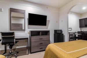 A television and/or entertainment center at Scottish Inn and Suites Baytown