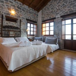 Кровать или кровати в номере Xemoni Hotel