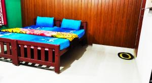 A bed or beds in a room at Periyar Green Bed & Breakfast