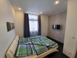 Ein Bett oder Betten in einem Zimmer der Unterkunft Altstadtherz