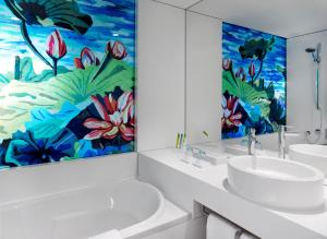 A bathroom at art'otel cologne by park plaza