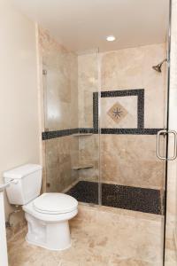 A bathroom at Beach Street Inn and Suites
