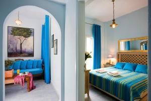 A bed or beds in a room at Alesahne Beach Hotel