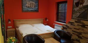 Ein Bett oder Betten in einem Zimmer der Unterkunft Gasthof Kaiser
