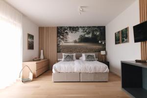 A bed or beds in a room at Hotel Majerca