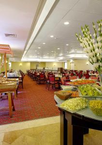 Een restaurant of ander eetgelegenheid bij Caesar Premier Jerusalem Hotel