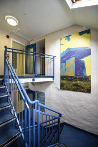 A balcony or terrace at Snoozles Quay Street Tourist Hostel
