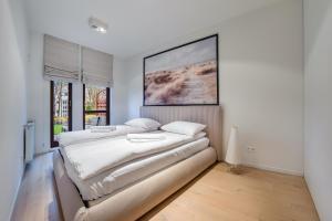 Łóżko lub łóżka w pokoju w obiekcie Apartamenty Sun & Snow Sopocka Rezydencja