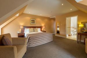 A bed or beds in a room at Sherbrooke Castle Hotel