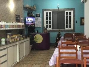 Um restaurante ou outro lugar para comer em Pousada Vicente Riocentro