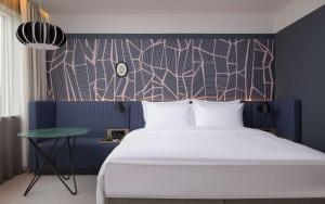 Letto o letti in una camera di Radisson Blu Hotel Lietuva