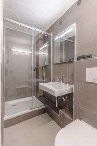 Ein Badezimmer in der Unterkunft APT. STONE-LODGE