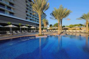 The swimming pool at or near Park Inn by Radisson Abu Dhabi Yas Island