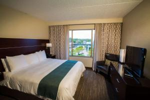 A television and/or entertainment center at Radisson On John Deere Commons Moline