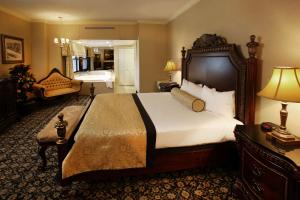 A bed or beds in a room at The Claridge - a Radisson Hotel