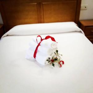 Cama o camas de una habitación en El roblón de cabuerniga