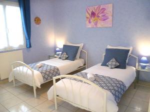 Un ou plusieurs lits dans un hébergement de l'établissement Les gites de Lescurou