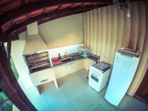 A kitchen or kitchenette at Pousada Bosque das Águas