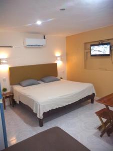 Cama o camas de una habitación en AMBAR Rooms & Coffee
