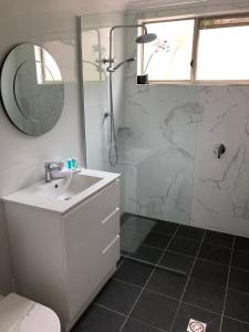A bathroom at Beaches Serviced Apartments