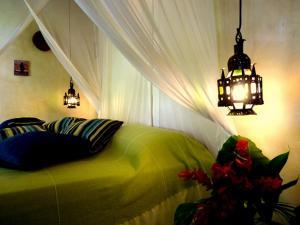 Cama ou camas em um quarto em Cor da Terra
