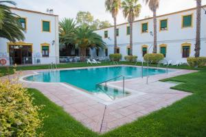 The swimming pool at or near Hotel Balneario El Raposo