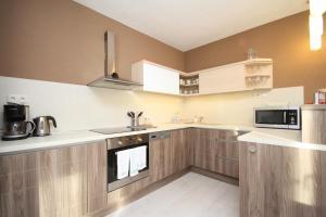 Kuchyň nebo kuchyňský kout v ubytování Simply Relax - Chopok