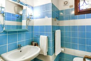 A bathroom at Colonna Hotel Country & Sporting