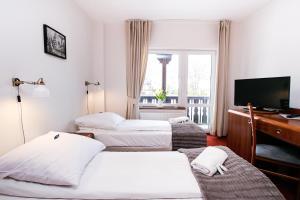 Łóżko lub łóżka w pokoju w obiekcie Rudy Lis Szczyrk