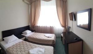 Кровать или кровати в номере Азимут Отель Прометей Небуг