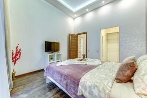 Кровать или кровати в номере Апартаменты Веста у канала Грибоедова