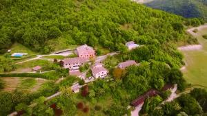 A bird's-eye view of Canapegna Village - private villas and 2 pools in the heart of Le Marche