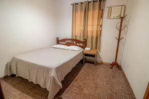 A bed or beds in a room at Casa central em Bonito-MS