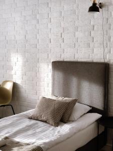 Łóżko lub łóżka w pokoju w obiekcie Hotel Łazienki Chodzieskie