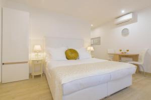A bed or beds in a room at Best location Apartments