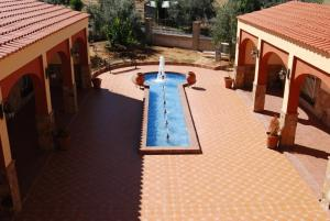 A view of the pool at Hotel Trajano or nearby