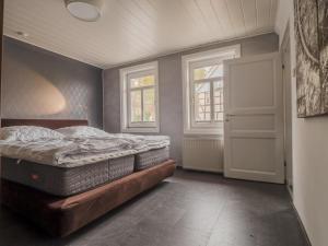 Ein Bett oder Betten in einem Zimmer der Unterkunft Ferienhaus Winde 8