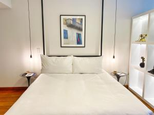 A bed or beds in a room at Elegant LOFT in Barranco
