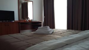 A bed or beds in a room at Hotel Terex