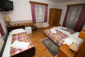 Postelja oz. postelje v sobi nastanitve Guesthouse Špenko