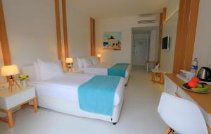 A bed or beds in a room at Labranda TMT Bodrum