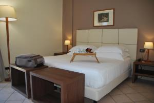 A bed or beds in a room at Domus Mariae Albergo