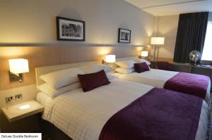 A bed or beds in a room at Lancaster Hotel and Spa