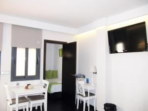 A television and/or entertainment center at Barcelona Fifteen Luxury Aparthotel
